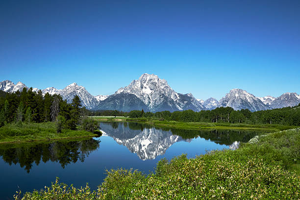 Grand Tetons from Oxbow Bend, Wyoming Grand Tetons reflected in still water of the Snake River at Oxbow Bend. rocky mountains north america stock pictures, royalty-free photos & images