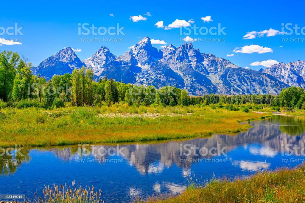 Grand Tetons mountains, summer, blue sky, water, reflections, Snake River stock photo