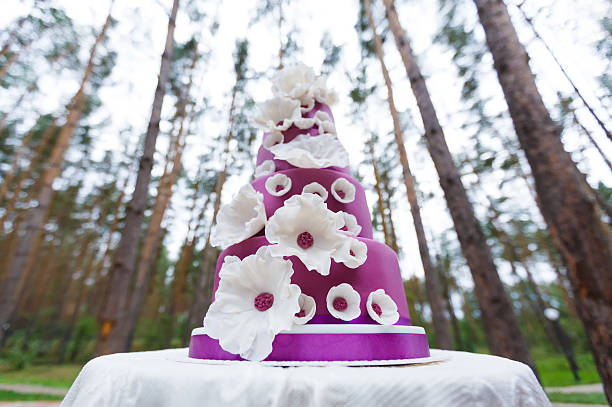 grand wedding cake with flowers - big cake stock photos and pictures