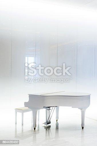 istock Grand white piano in white interior, Greece 864435432
