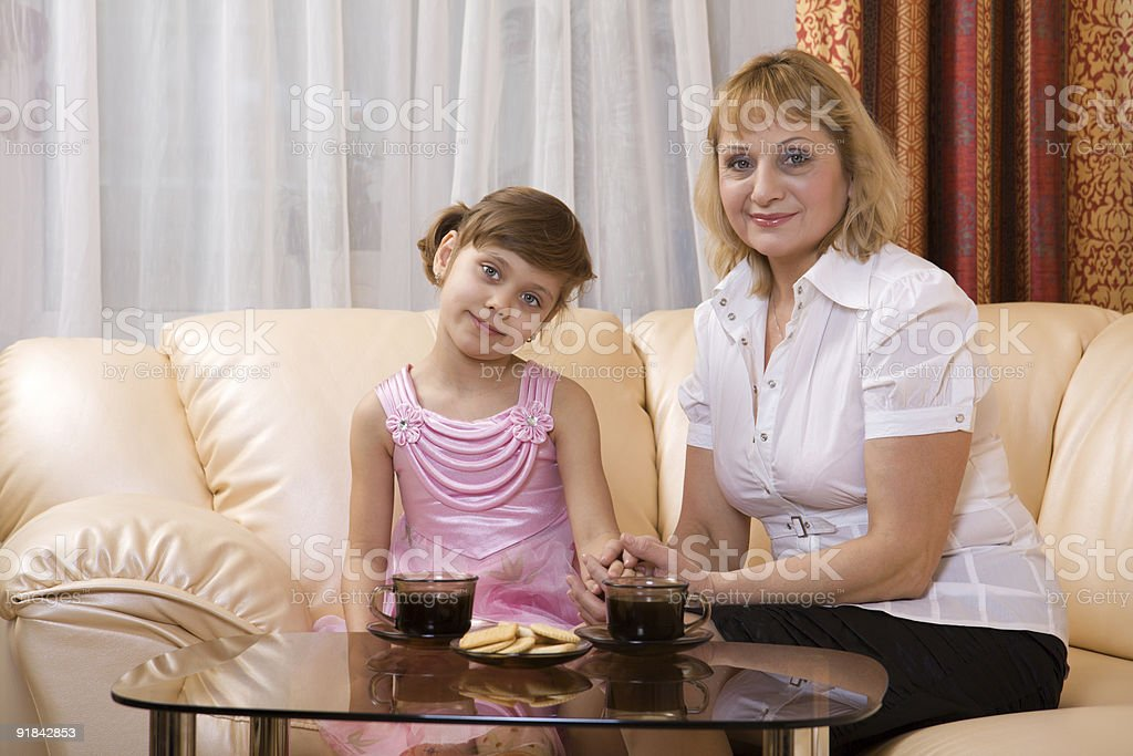 Grandchild and grandmother drink tea royalty-free stock photo