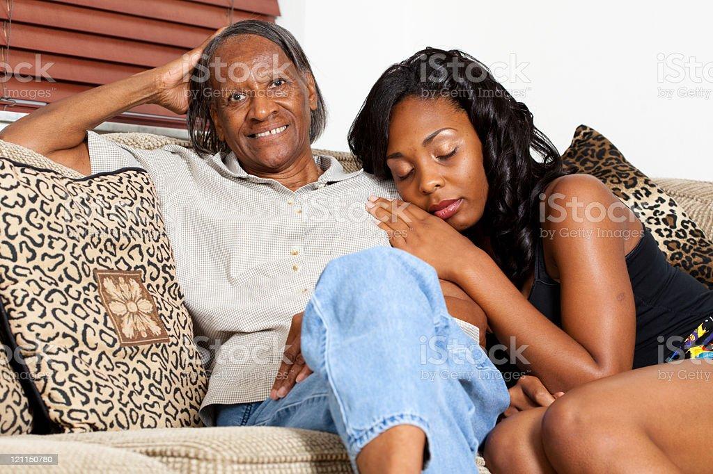 Grandchild leaning at Grandma's shoulder stock photo
