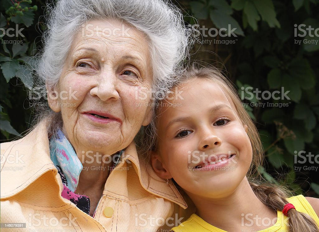 Granddaughter and her grandmother royalty-free stock photo