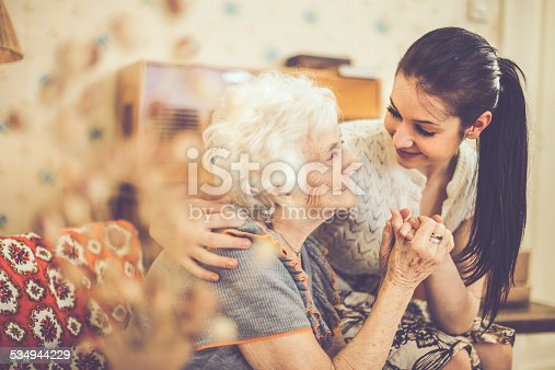 istock Granddaughter embracing her happy grandmother at home 534944229