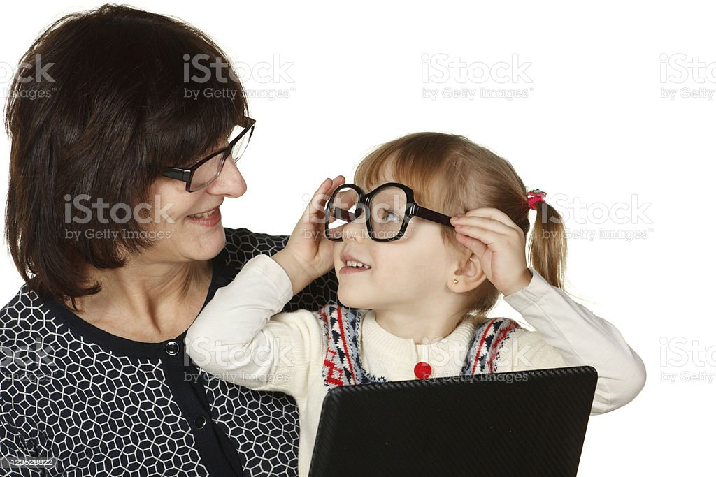 Granddaughter fooling with grandmother's glasses royalty-free stock photo