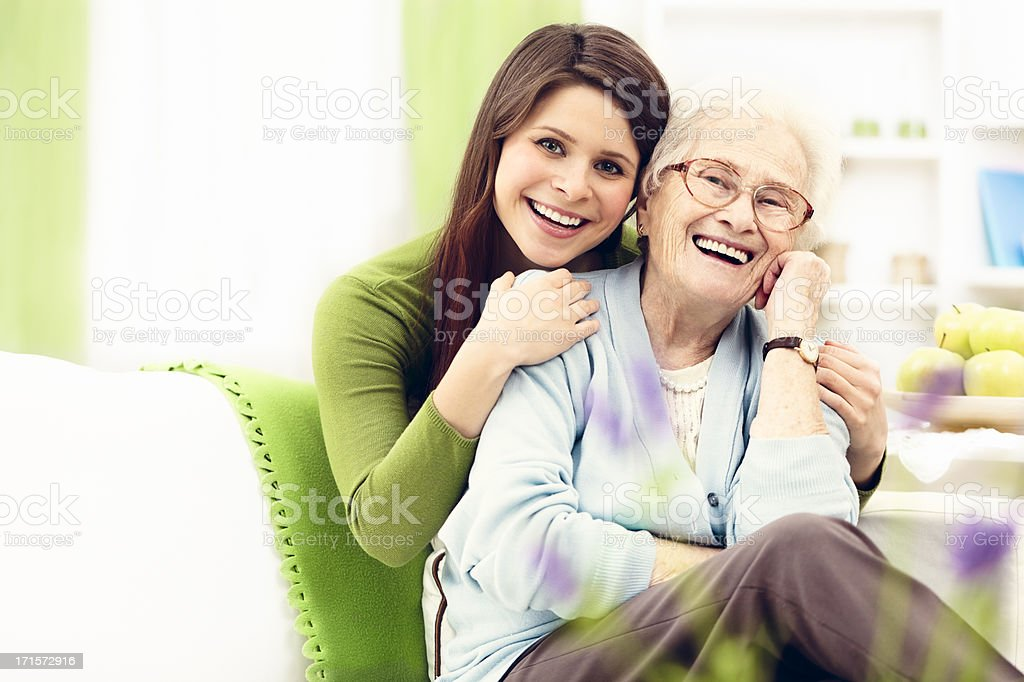 Granddaughter hugging her grandmother royalty-free stock photo