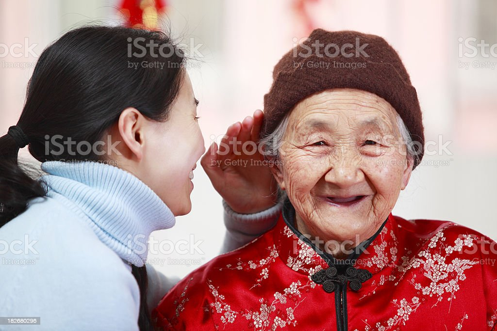 granddaughter talking with grandmother royalty-free stock photo