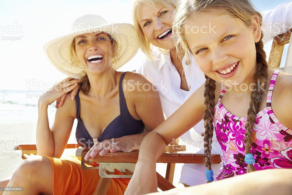 Granddaughter with mother and grandmother at beach royalty-free stock photo