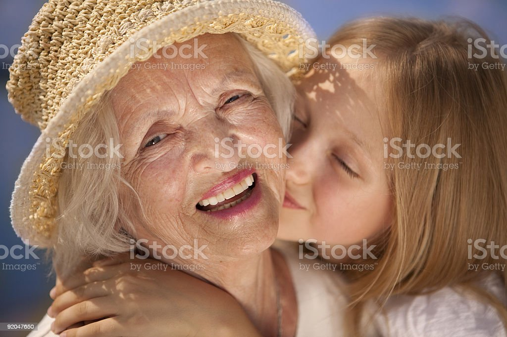 Granddaughter's Kiss. XXXL royalty-free stock photo
