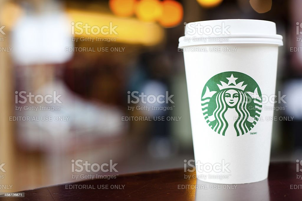 Grande Starbucks to go cup on table stock photo