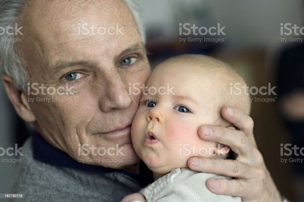 Grandfather and Baby stock photo