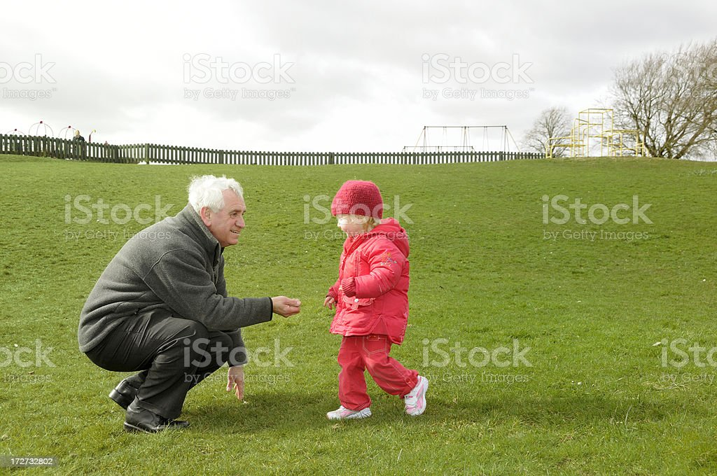 grandfather and grandaughter in park royalty-free stock photo