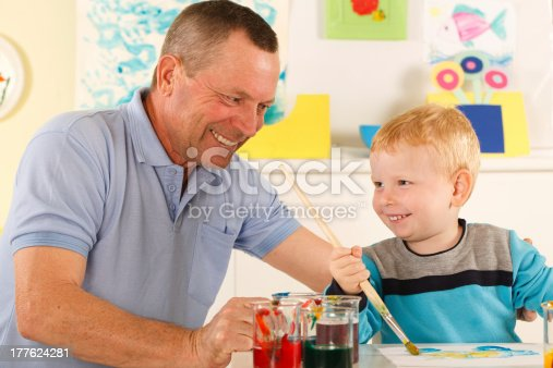 istock Grandfather and grandchild draws together 177624281