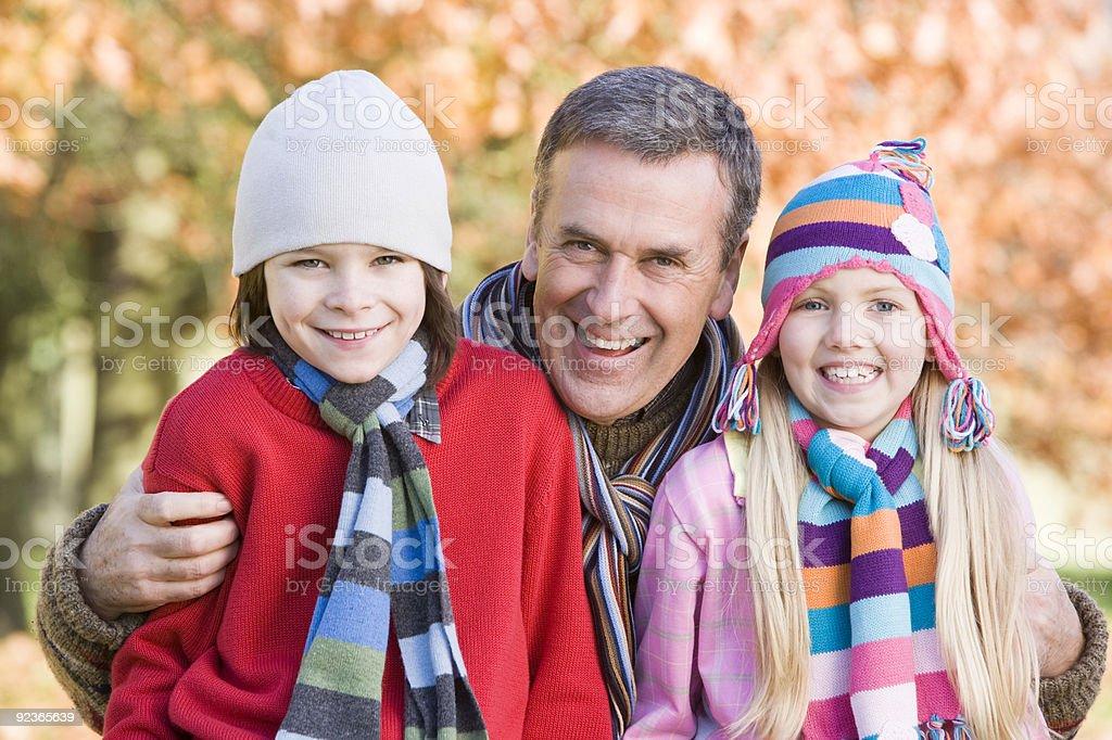Grandfather and grandchildren on walk royalty-free stock photo