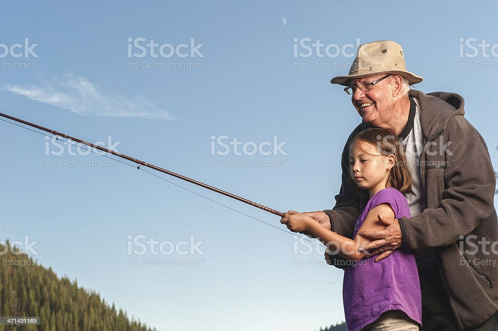 Grandfather and Granddaughter Fishing royalty-free stock photo