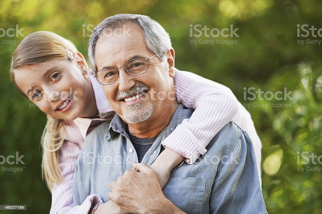 Grandfather And Granddaughter In Backyard stock photo