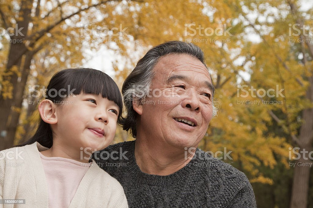 Grandfather and granddaughter in park royalty-free stock photo