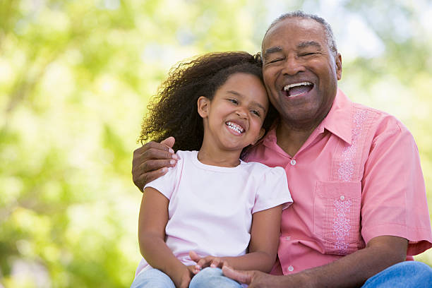 Grandfather and granddaughter outdoor portrait stock photo