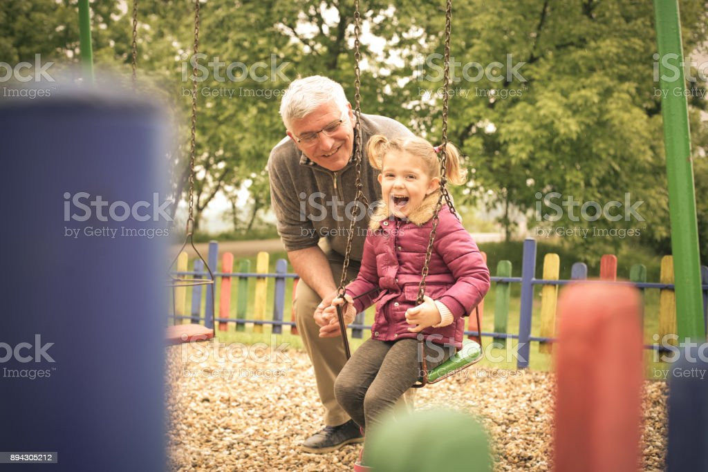 Grandfather and granddaughter. stock photo