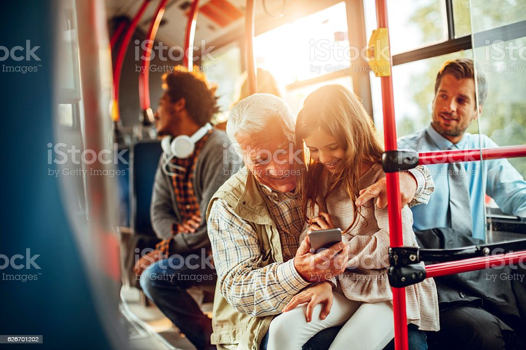 Grandfather and granddaughter riding in a bus - Lizenzfrei 6-7 Jahre Stock-Foto