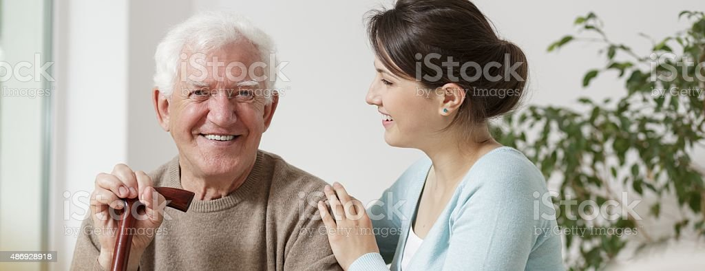 Grandfather and granddaughter spending time stock photo
