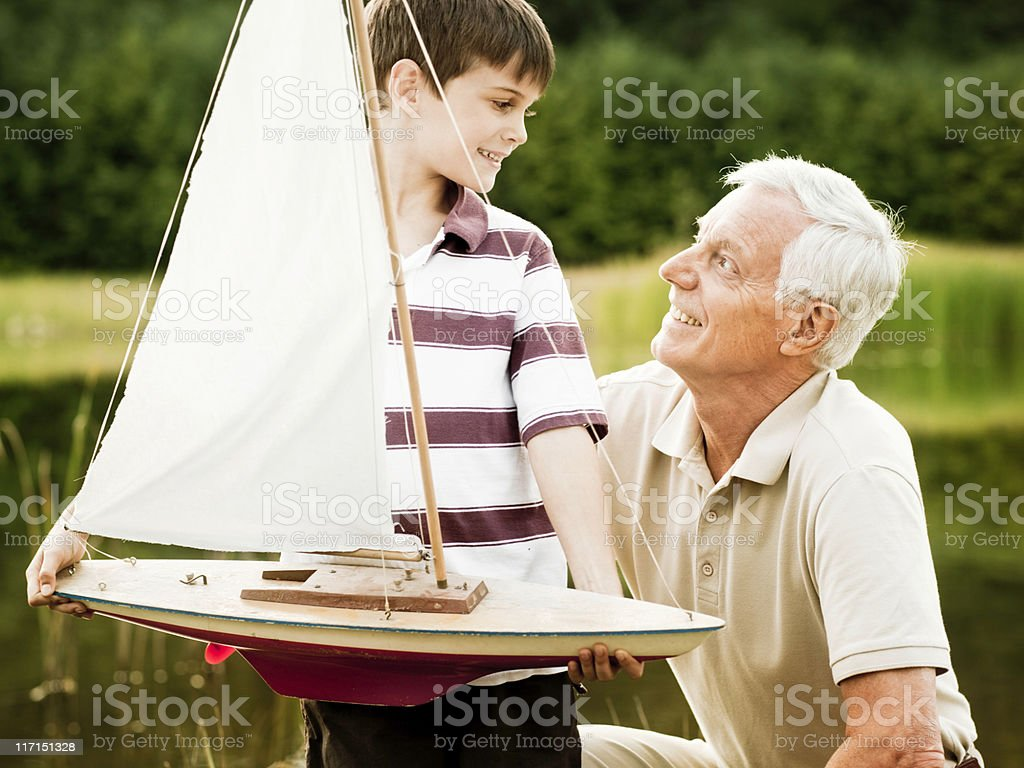 Grandfather and Grandson at the Park royalty-free stock photo