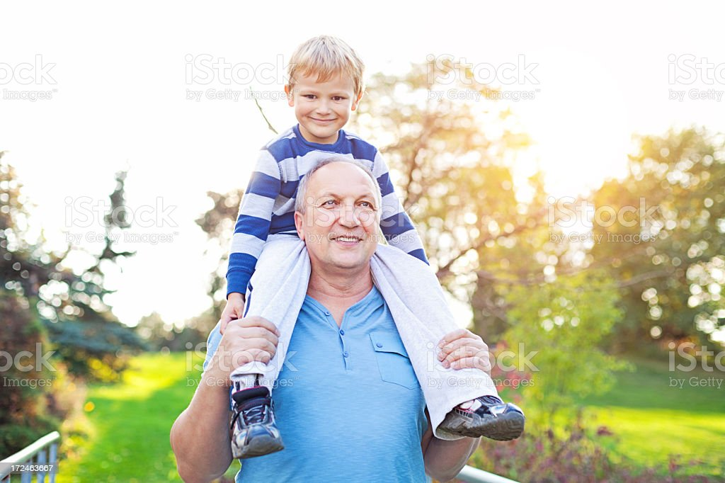 Grandfather and grandson at the park. royalty-free stock photo