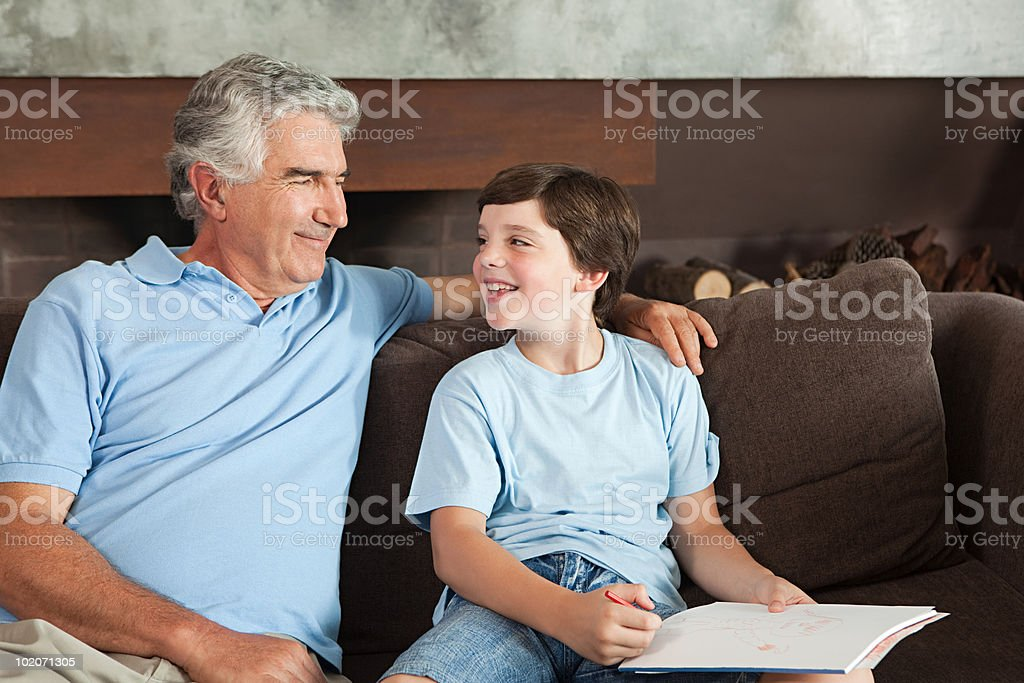 Grandfather and grandson drawing royalty-free stock photo