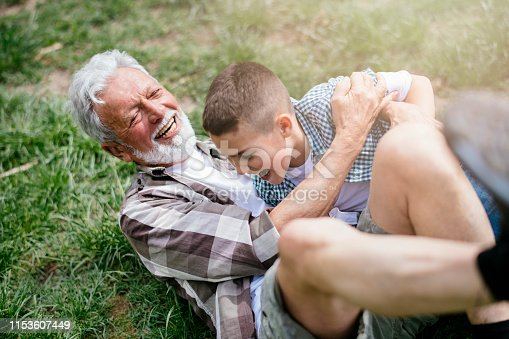 639800036istockphoto Grandfather and grandson enjoy a game 1153607449