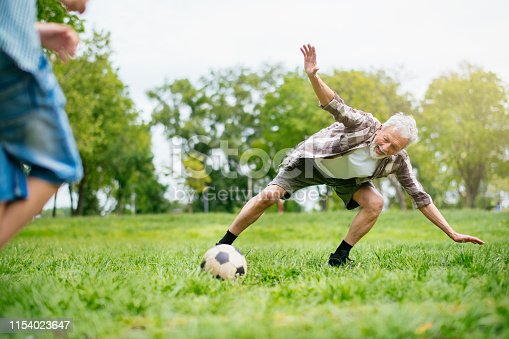 639800036istockphoto Grandfather and grandson enjoy a game 1154023647