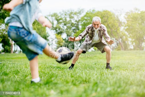 639800036istockphoto Grandfather and grandson enjoy a game 1154024013