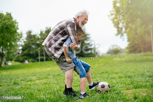 639800036istockphoto Grandfather and grandson enjoy a game 1154024048