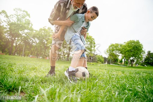 639800036istockphoto Grandfather and grandson enjoy a game 1154362025