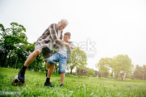 639800036istockphoto Grandfather and grandson enjoy a game 1154362170