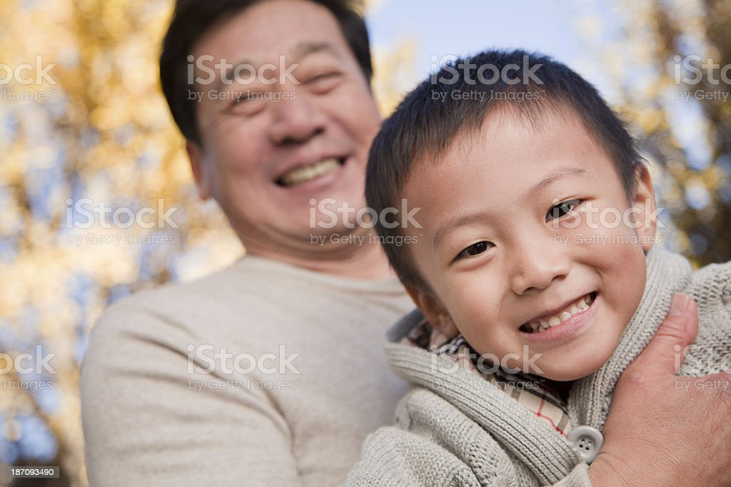 Grandfather and Grandson Enjoying in the Park royalty-free stock photo
