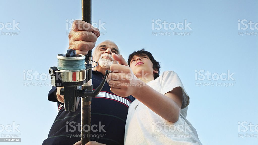 Grandfather and Grandson Fishing royalty-free stock photo