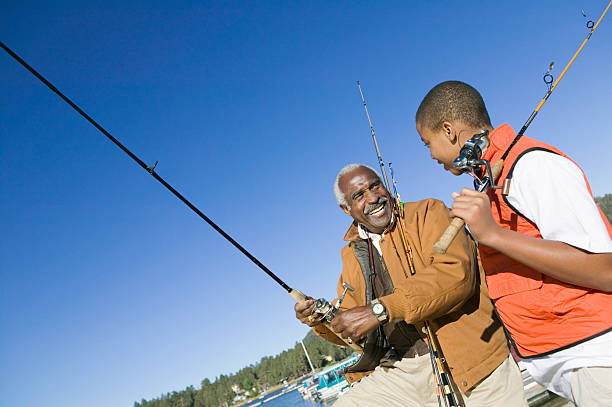 Grandfather and Grandson Fishing stock photo