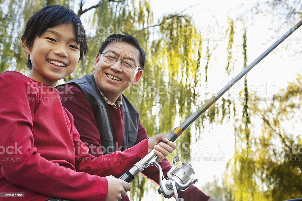 Grandfather and grandson fishing portrait royalty-free stock photo