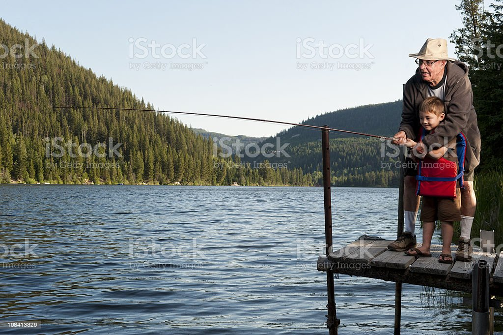 Grandfather and Grandson Fishing Together royalty-free stock photo