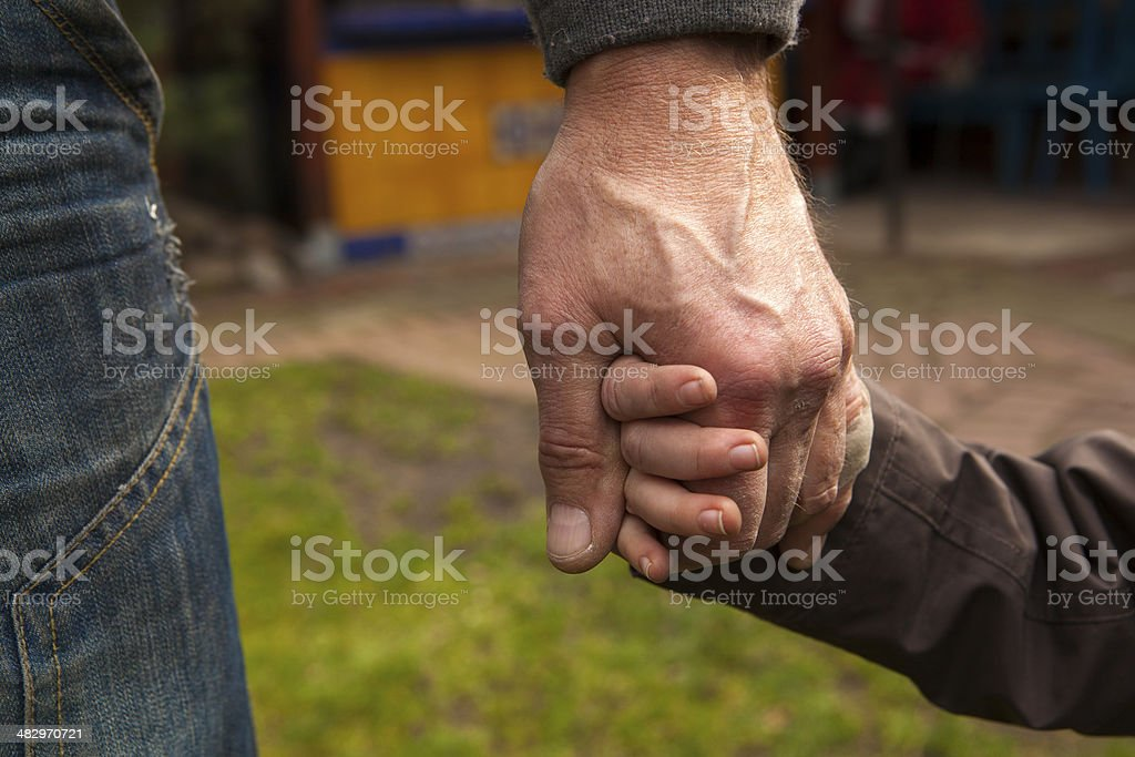 Grandfather and grandson for a walk stock photo