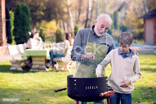 istock Grandfather and Grandson Having a Barbecue 638899582
