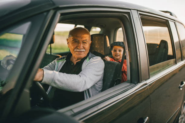 Grandfather and grandson having fun on the roadtrip stock photo