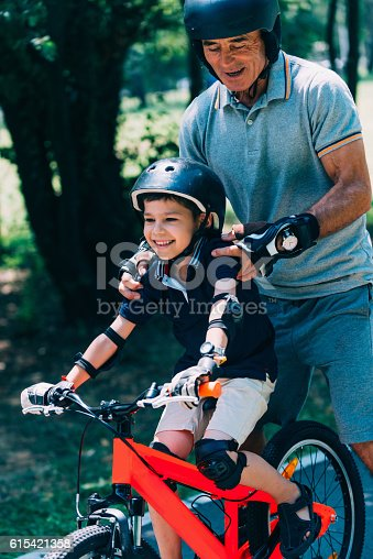 853720192 istock photo Grandfather and grandson having good time 615421358