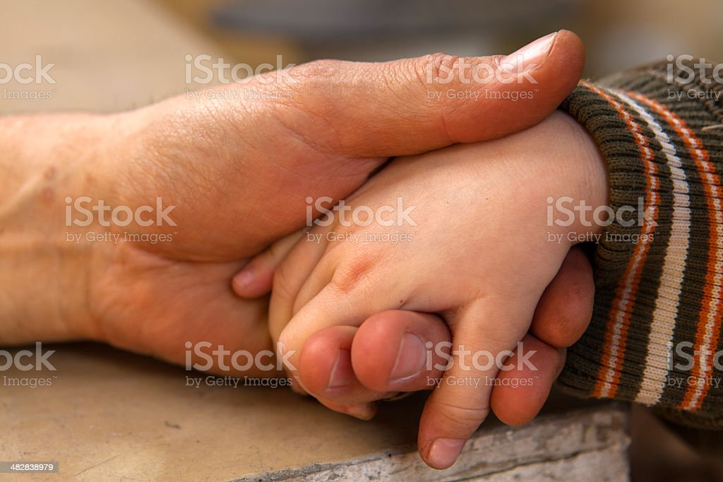 Grandfather and grandson holding hands stock photo
