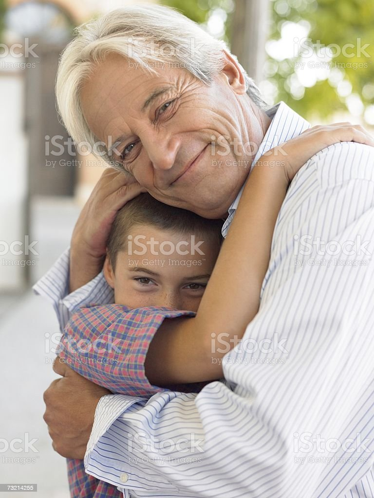Grandfather and grandson hugging royalty-free stock photo