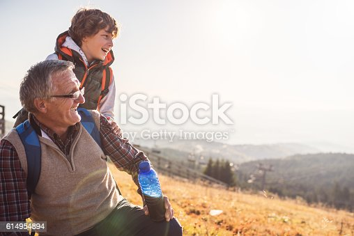 Grandfather and grandson having wonderful day in nature.