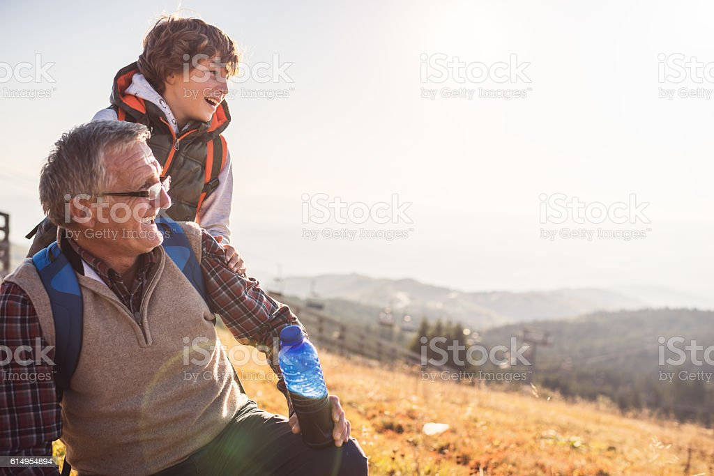 Grandfather and grandson in nature stock photo