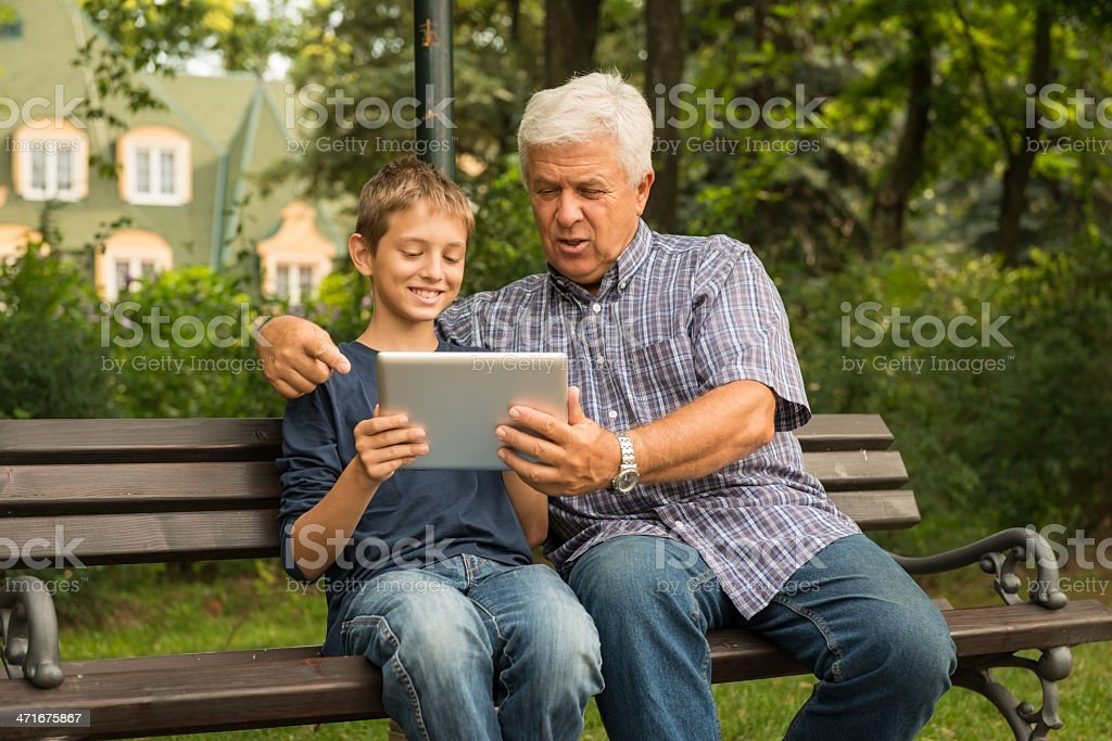 Grandfather and grandson in the park royalty-free stock photo