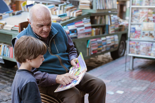 Grandfather and grandson in the streets stock photo