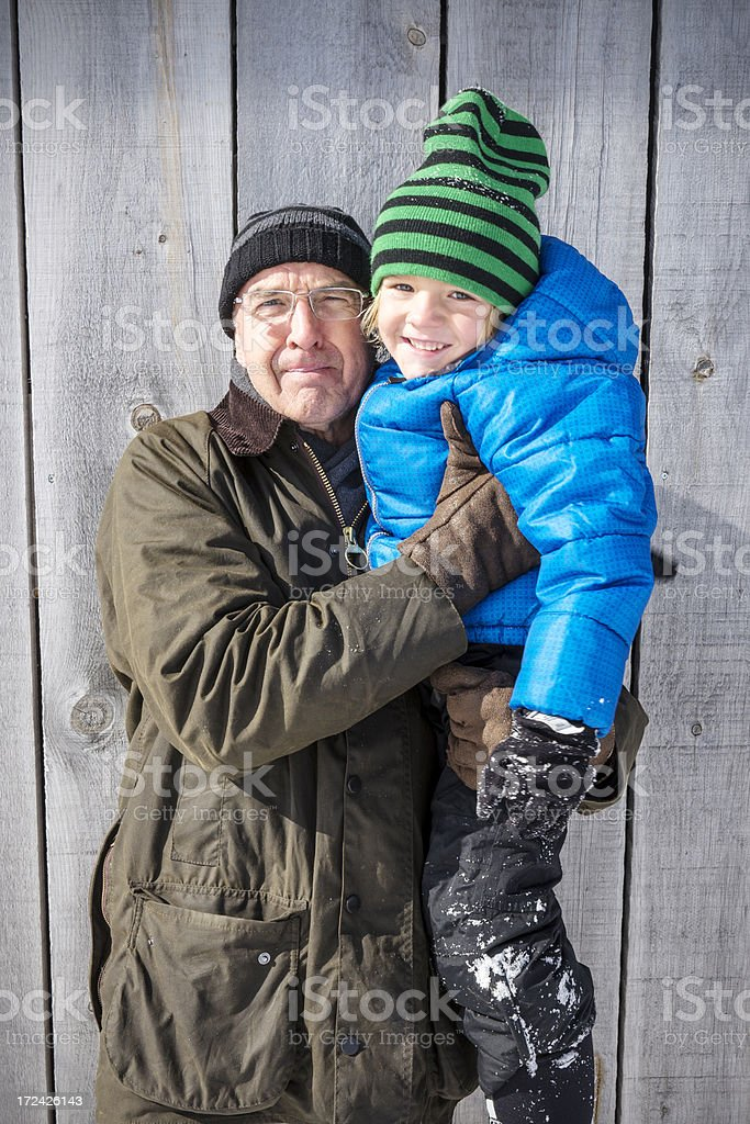 Grandfather and grandson in winter royalty-free stock photo